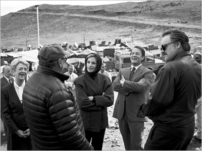 Nancy Linehan Charles, Director Mike Nichols (back to camera), Julia Roberts, Tom Hanks, and Philip Seymour Hoffman during filming of Charlie Wilson's War PHOTOGRAPH BY BRIGITTE LACOMBE